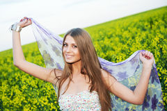 Girl with hands up at summer field Stock Image