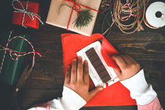 Girl hands wrapping gift for Christmas presents and New Year. Stock Image