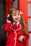 Girl with handset Royalty Free Stock Photo