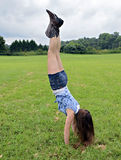 Girl Handstand Outdoors Stock Image