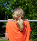Girl hanging on bar Royalty Free Stock Images