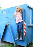 Girl hanging on blue container Royalty Free Stock Photo