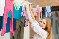 Girl hanging clothes   on clothesline Stock Photo