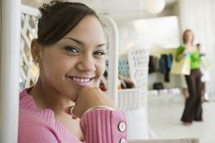 Girl Hanging Out in Boutique Stock Photography