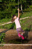 Girl hanging on rope Royalty Free Stock Photos