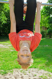 Girl hanging upside down Royalty Free Stock Images