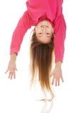Girl hanging upside down Royalty Free Stock Photo