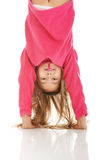Girl hanging upside down Royalty Free Stock Image