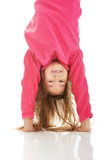 Girl hanging upside down Royalty Free Stock Photos