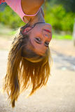 Girl hanging upside down Royalty Free Stock Photography