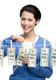 Girl hangs money on the line Stock Photo