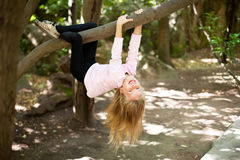 Girl hangs from a tree Royalty Free Stock Photography