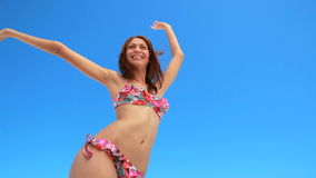 Girl happily dancing in her bikini Stock Photo