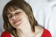 Girl is happy. Girl with closed eyes sleep Royalty Free Stock Photo