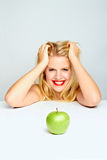 Girl happy about an apple Royalty Free Stock Photography