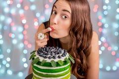 Girl with happy birthday cake Stock Photography