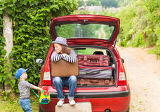 Girl happy child travel suitcases car summer landscape Stock Image