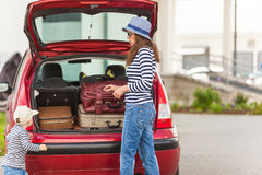 Girl happy child travel suitcases car summer landscape Stock Photo