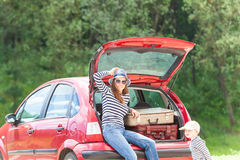 Girl happy child travel suitcases car summer landscape Stock Photography