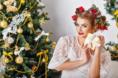 Girl is happy Christmas present. Royalty Free Stock Photo