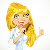Girl happy and easy combing obedient blonde hair Royalty Free Stock Photo