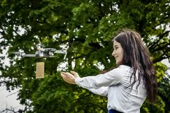 The girl is happy with the gift delivered by the drone stock image