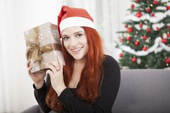 Girl is happy hold christmas present Royalty Free Stock Photo