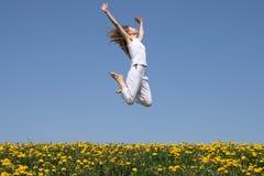 Girl in a happy jump Stock Photos