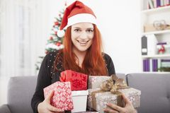 Girl is happy with a lot christmas present Stock Photos