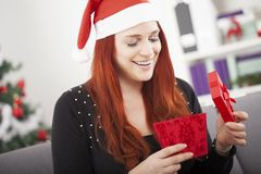 Girl is happy open christmas present Royalty Free Stock Photo