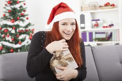 Girl is happy open christmas present Royalty Free Stock Photos