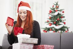 Girl is happy open christmas present Stock Images