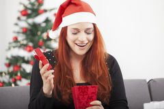 Girl is happy open christmas present Stock Photo