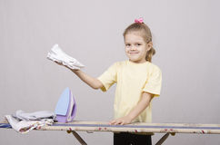 Girl happy stroking things iron Stock Photo