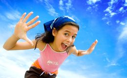 girl happy in swimming costume with blue sky Royalty Free Stock Photo