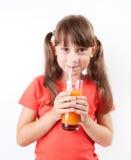 Girl happy to drink fresh juice Stock Image