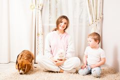Girl shine with happiness. The girl is happy to spend her time for her small brither and animals Royalty Free Stock Photos