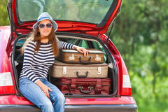 Girl happy  travel suitcases car summer landscape Stock Photos