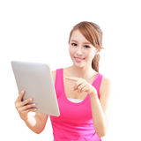 Girl happy using tablet pc computer Stock Images