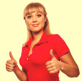 Girl happy woman young shows positive sign thumbs yes, in red sh Stock Images