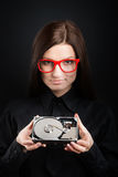 Girl with a hard disk drive Royalty Free Stock Photography