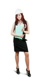 Girl in hard hat  with documents Royalty Free Stock Photography