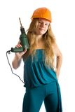 Girl in hard hat with drill Royalty Free Stock Photo