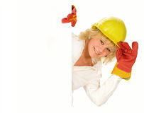 Girl in hardhat. Behind the empty board Stock Photo