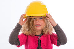 Girl with hardhat Stock Image