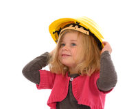 Girl with hardhat. Girl with yellow hardhat is happy Royalty Free Stock Photo