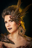 Girl harpy. Creative make-up for Halloween. The concept of a mythical creature Stock Images