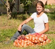 Girl with harvested onion Stock Photo