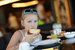 Girl has breakfast Royalty Free Stock Images