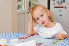 Girl has breakfast in the morning Royalty Free Stock Image